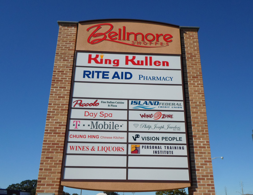 bellmore shoppes pylon monument sign tee pee signs long island shopping center nyc brick